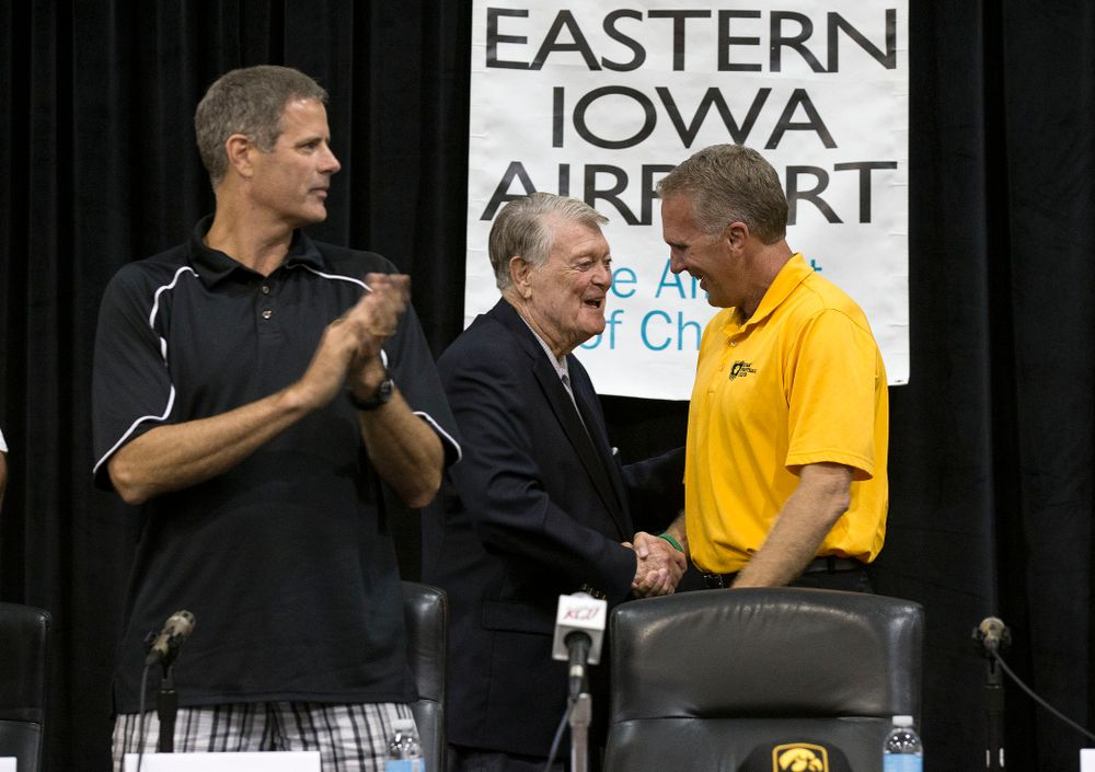 Former Hawkeye Football Head Coach Hayden Fry shakes hands with former quarterback Chuck Long during a panel discussion at Fry Fest Friday, Aug. 29, 2014 in Coralville.  (Brian Ray/hawkeyesports.com)