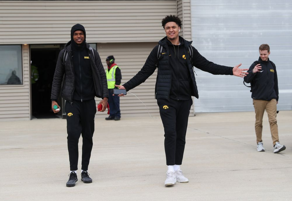 Iowa Hawkeyes forward Cordell Pemsl (35) and guard Maishe Dailey (1) board a flight to Columbus for the first and second rounds of the 2019 NCAA Men's Basketball Tournament Wednesday, March 20, 2019 at the Eastern Iowa Airport. (Brian Ray/hawkeyesports.com)