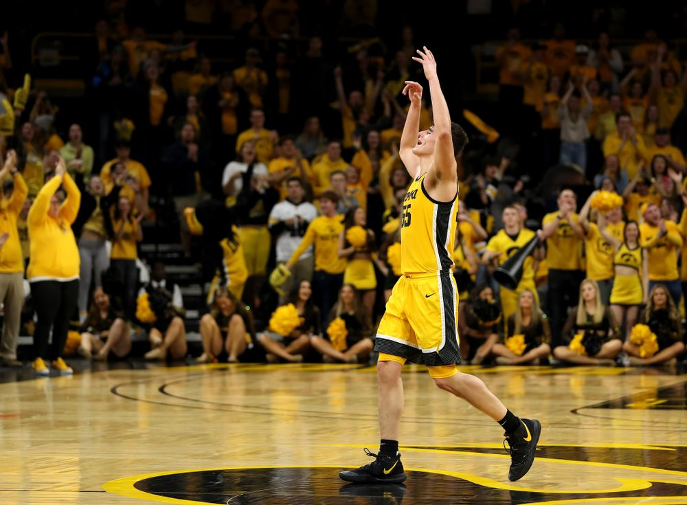 Iowa Hawkeyes forward Luka Garza (55) celebrates late in the game against the Rutgers Scarlet Knights  Wednesday, January 22, 2020 at Carver-Hawkeye Arena. (Brian Ray/hawkeyesports.com)