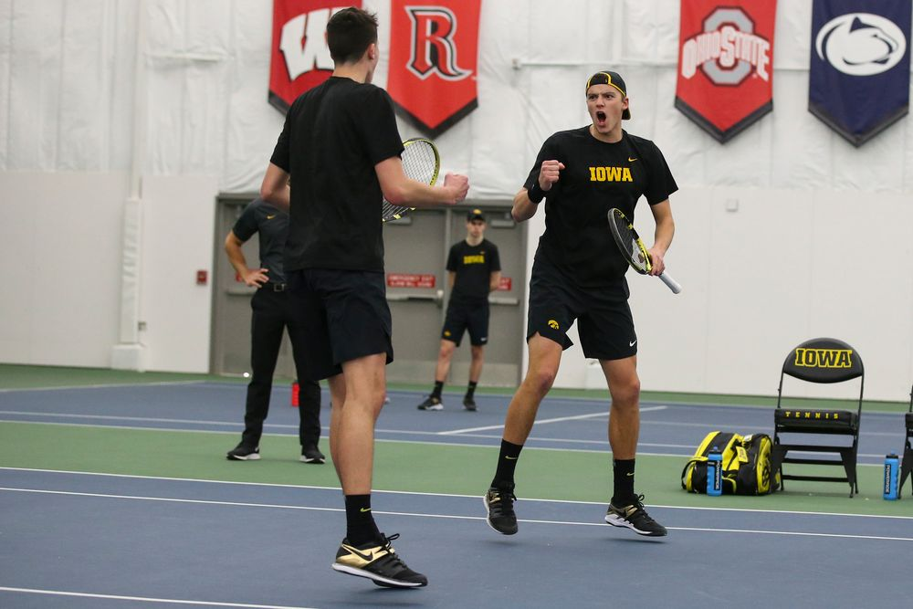 Iowa's Matt Clegg and Joe Tyler celebrate a point during the Iowa men's tennis meet vs VCU  on Saturday, February 29, 2020 at the Hawkeye Tennis and Recreation Complex. (Lily Smith/hawkeyesports.com)