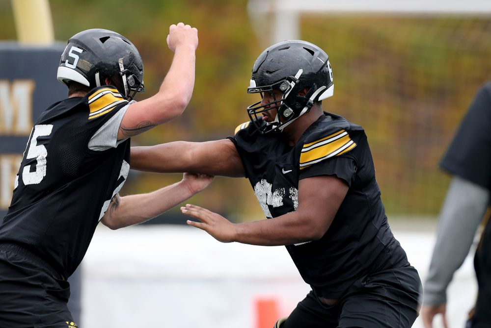 Iowa Hawkeyes offensive lineman Justin Britt (63) and offensive lineman Jeff Jenkins (75) during practice Sunday, December 22, 2019 at Mesa College in San Diego. (Brian Ray/hawkeyesports.com)