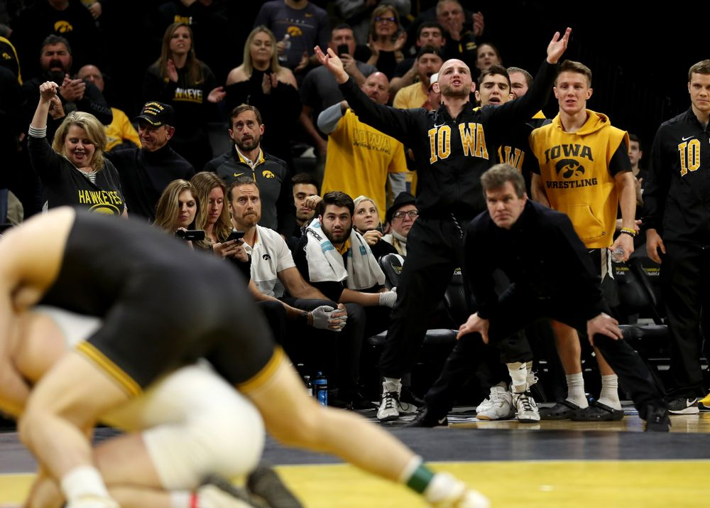Alex Marinelli cheers as Iowa's Abe Assad wrestles Ohio State's Rockey Jordan at 184 pounds Friday, January 24, 2020 at Carver-Hawkeye Arena. Assad won the match 3-1. (Brian Ray/hawkeyesports.com)