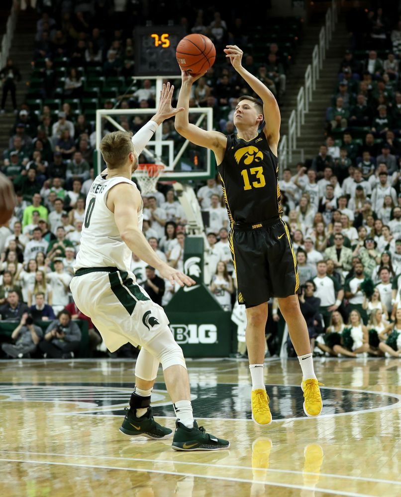 Iowa Hawkeyes guard Austin Ash (13) against Michigan State Tuesday, February 25, 2020 at the Breslin Center in East Lansing, MI. (Brian Ray/hawkeyesports.com)