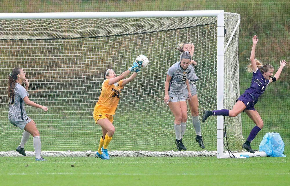 Iowa goalkeeper Claire Graves (34) gets her hands on a shot during the second half of their match at the Iowa Soccer Complex in Iowa City on Sunday, Sep 29, 2019. (Stephen Mally/hawkeyesports.com)