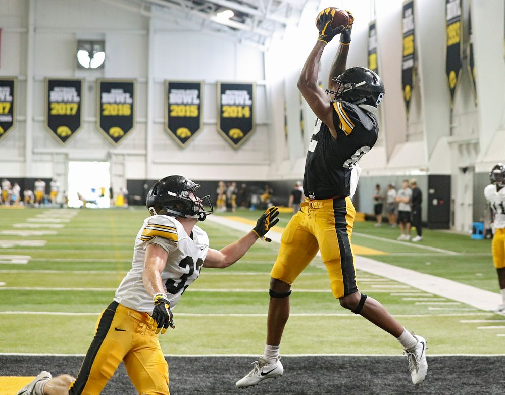 Iowa Hawkeyes wide receiver Calvin Lockett (right) pulls in a pass as defensive back Riley Moss (left) defends during Fall Camp Practice No. 6 at the Hansen Football Performance Center in Iowa City on Thursday, Aug 8, 2019. (Stephen Mally/hawkeyesports.com)