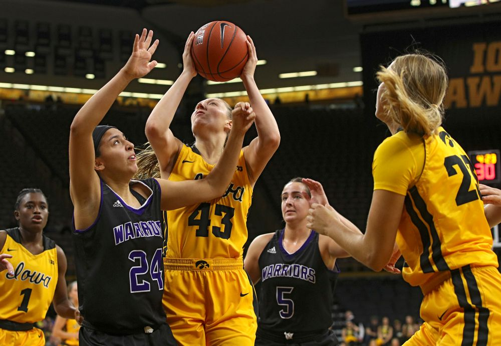 Iowa forward Amanda Ollinger (43) makes a basket during the fourth quarter of their game against Winona State at Carver-Hawkeye Arena in Iowa City on Sunday, Nov 3, 2019. (Stephen Mally/hawkeyesports.com)