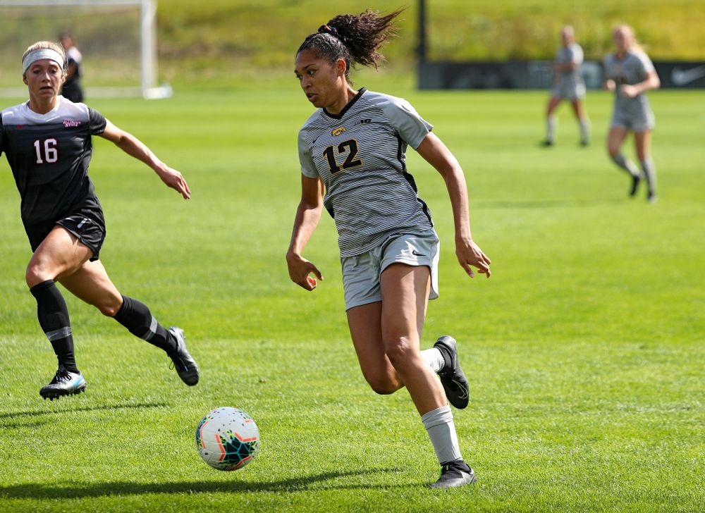 Iowa forward Olivia Fiegel (12) moves with the ball during the first half of their match at the Iowa Soccer Complex in Iowa City on Sunday, Sep 1, 2019. (Stephen Mally/hawkeyesports.com)