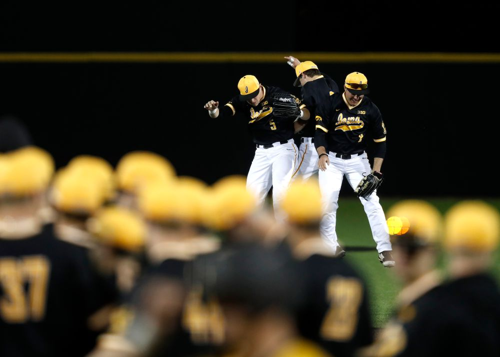 Iowa Hawkeyes catcher Tyler Cropley (5), outfielder Ben Norman (9), and outfielder Luke Farley (8) against Milwaukee Wednesday, April 25, 2018 at Duane Banks Field. (Brian Ray/hawkeyesports.com)