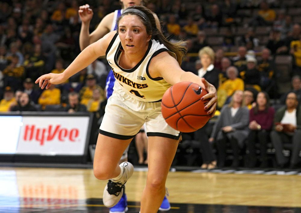Iowa Hawkeyes guard Mckenna Warnock (14) saves a ball from going out of bounds during the fourth quarter of their game at Carver-Hawkeye Arena in Iowa City on Saturday, December 21, 2019. (Stephen Mally/hawkeyesports.com)