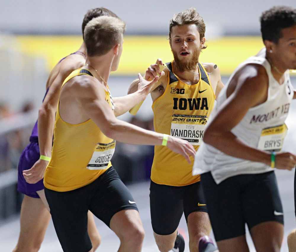 Iowa's Tysen VanDraska (right) hands the baton to Spencer Gudgel as they run the men's 1600 meter relay event during the Jimmy Grant Invitational at the Recreation Building in Iowa City on Saturday, December 14, 2019. (Stephen Mally/hawkeyesports.com)