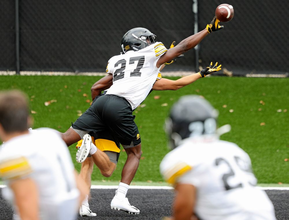 Iowa Hawkeyes defensive back Jermari Harris (27) knocks a pass away intended for wide receiver Calvin Lockett (82) during Fall Camp Practice No. 15 at the Hansen Football Performance Center in Iowa City on Monday, Aug 19, 2019. (Stephen Mally/hawkeyesports.com)