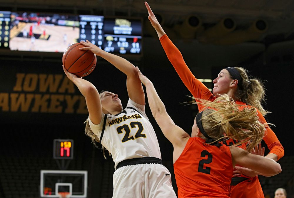 Iowa guard Kathleen Doyle (22) is fouled as she shoots during the first quarter of their overtime win against Princeton at Carver-Hawkeye Arena in Iowa City on Wednesday, Nov 20, 2019. (Stephen Mally/hawkeyesports.com)