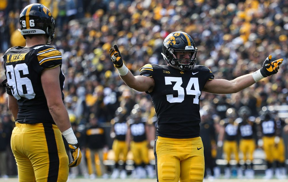Iowa Hawkeyes linebacker Kristian Welch (34) pumps up the crowd during a game against Maryland at Kinnick Stadium on October 20, 2018. (Tork Mason/hawkeyesports.com)