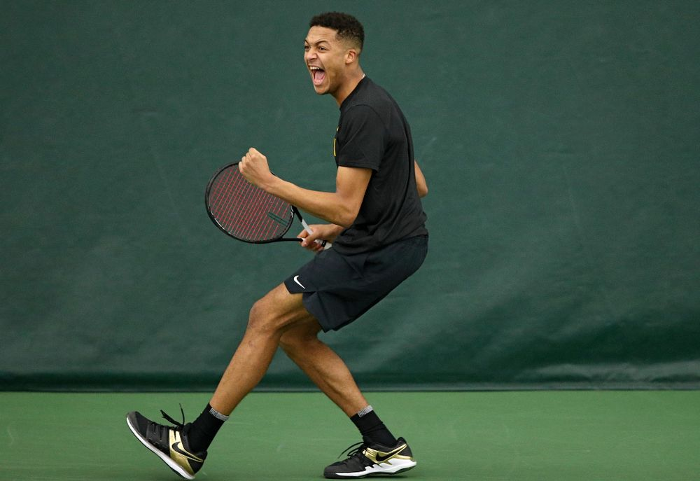 Iowa's Oliver Okonkwo celebrates a point during their match at the Hawkeye Tennis and Recreation Complex in Iowa City on Thursday, January 16, 2020. (Stephen Mally/hawkeyesports.com)