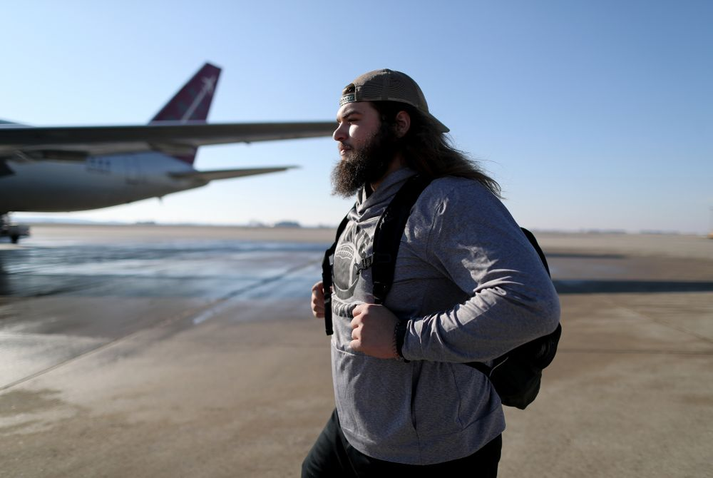 Iowa Hawkeyes offensive lineman Kyler Schott (64) boards the team plane at the Eastern Iowa Airport Saturday, December 21, 2019 on the way to San Diego, CA for the Holiday Bowl. (Brian Ray/hawkeyesports.com)