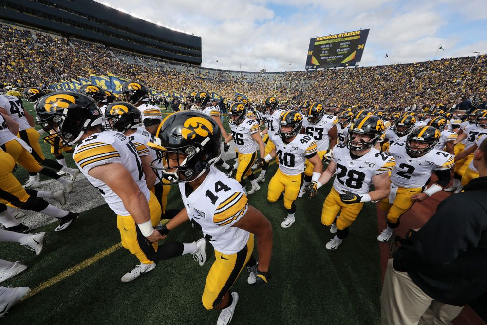 The Iowa Hawkeyes swarm on to the field for their game against the Michigan Wolverines Saturday, October 5, 2019 at Michigan Stadium in Ann Arbor, MI. (Brian Ray/hawkeyesports.com)