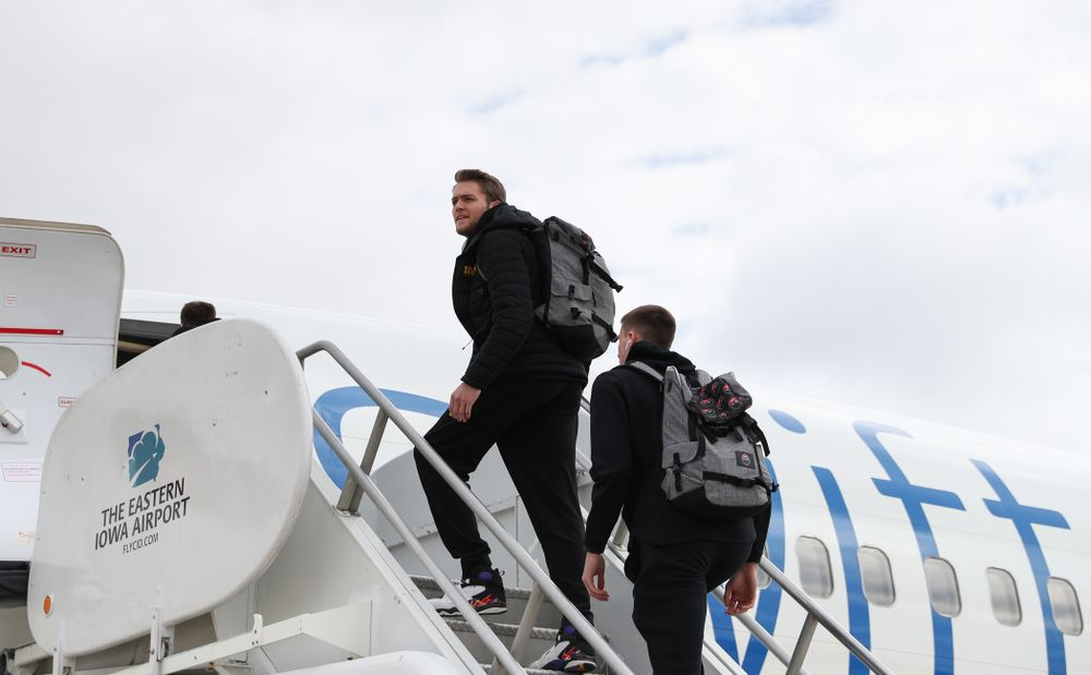 Iowa Hawkeyes forward Riley Till (20) boards a flight to Columbus for the first and second rounds of the 2019 NCAA Men's Basketball Tournament Wednesday, March 20, 2019 at the Eastern Iowa Airport. (Brian Ray/hawkeyesports.com)