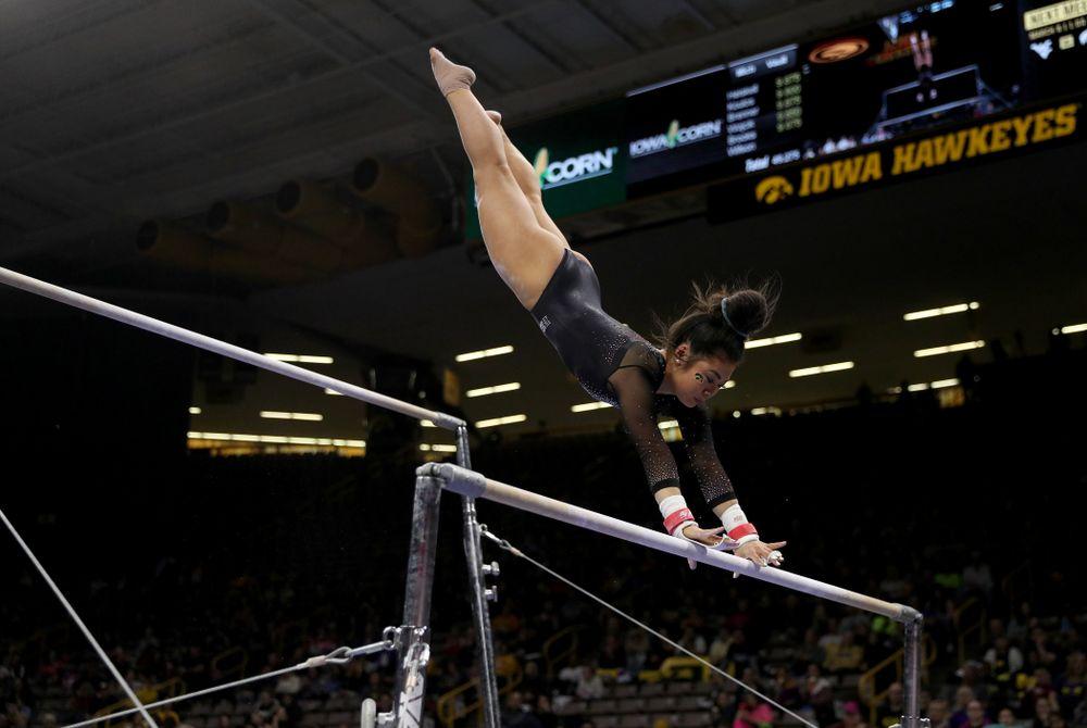 Iowa's Clair Kaji competes on the bars against Michigan Friday, February 14, 2020 at Carver-Hawkeye Arena. (Brian Ray/hawkeyesports.com)