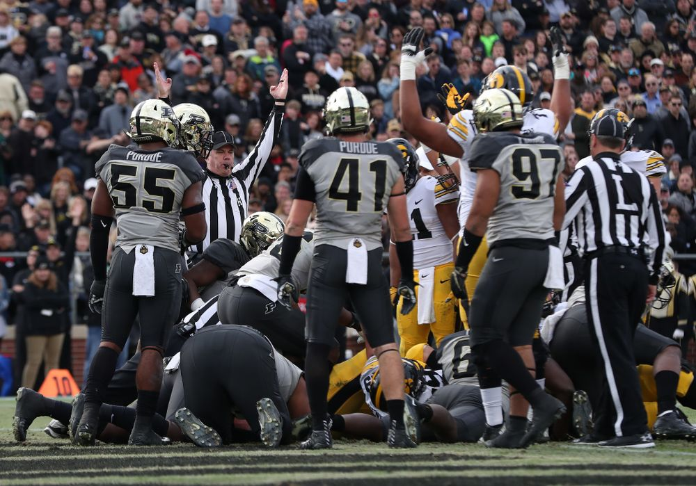 Iowa Hawkeyes quarterback Nate Stanley (4) scores a touchdown against the Purdue Boilermakers Saturday, November 3, 2018 Ross Ade Stadium in West Lafayette, Ind. (Brian Ray/hawkeyesports.com)