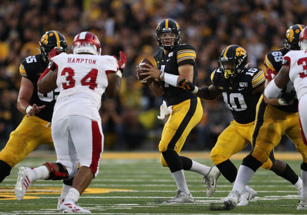 Iowa Hawkeyes quarterback Nate Stanley (4) against the Miami RedHawks Saturday, August 31, 2019 at Kinnick Stadium in Iowa City. (Brian Ray/hawkeyesports.com)