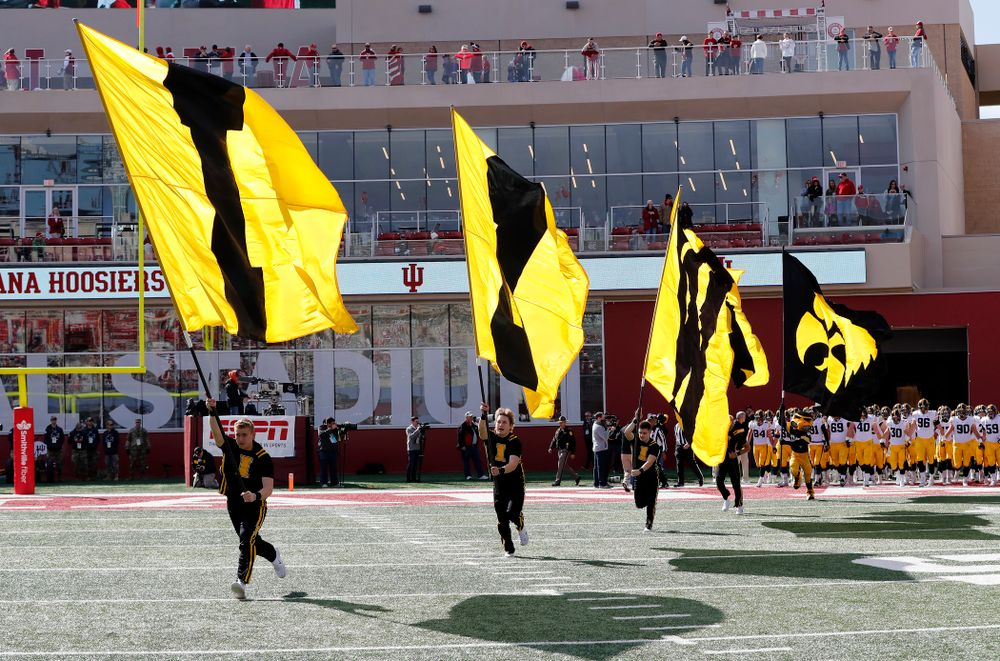 The Iowa Spirit Squad brings out the IOWA flags against the Indiana Hoosiers Saturday, October 13, 2018 at Memorial Stadium, in Bloomington, Ind. (Brian Ray/hawkeyesports.com)