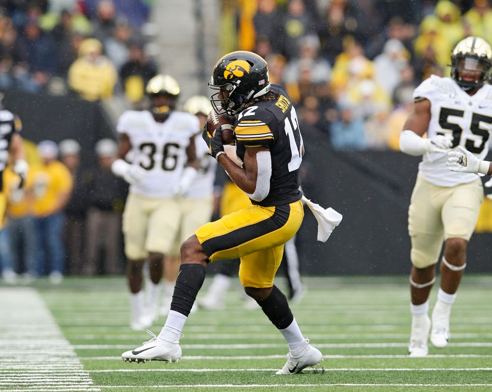 Iowa Hawkeyes wide receiver Brandon Smith (12) pulls in a pass during the third quarter of their game at Kinnick Stadium in Iowa City on Saturday, Oct 19, 2019. (Stephen Mally/hawkeyesports.com)