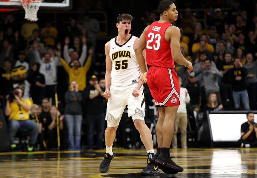 Iowa Hawkeyes forward Luka Garza (55) reacts after making a three point basket against the Ohio State Buckeyes Saturday, January 12, 2019 at Carver-Hawkeye Arena. (Brian Ray/hawkeyesports.com)