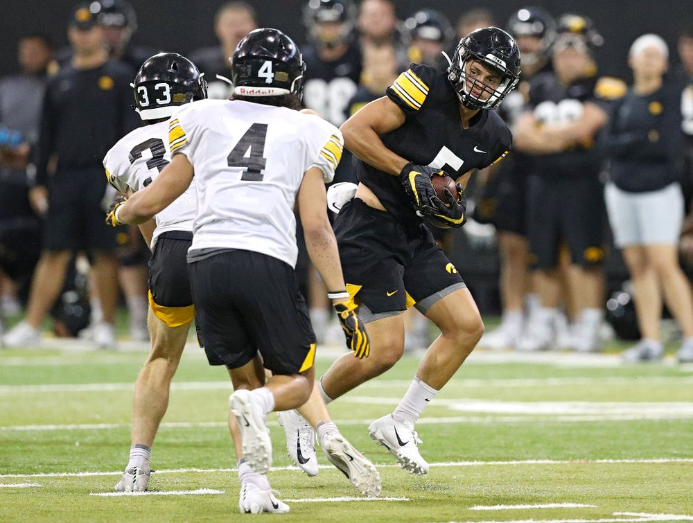 Iowa Hawkeyes wide receiver Oliver Martin (5) pulls in a pass as defensive back Riley Moss (33) and defensive back Dane Belton (4) close in during Fall Camp Practice No. 9 at the Hansen Football Performance Center in Iowa City on Monday, Aug 12, 2019. (Stephen Mally/hawkeyesports.com)