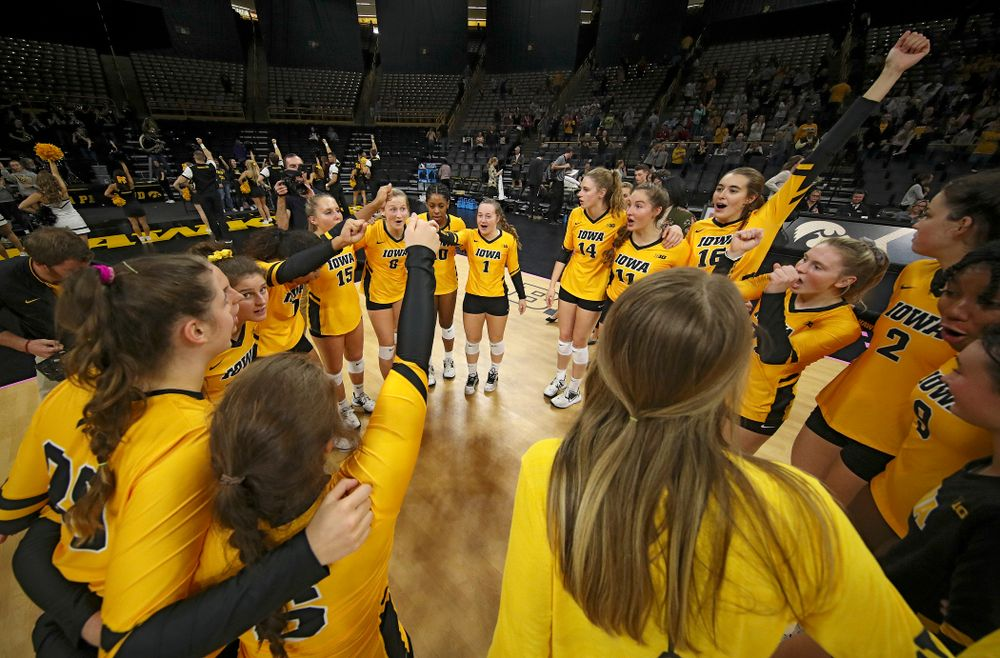 The Iowa Hawkeye celebrate after winning their match at Carver-Hawkeye Arena in Iowa City on Sunday, Oct 20, 2019. (Stephen Mally/hawkeyesports.com)