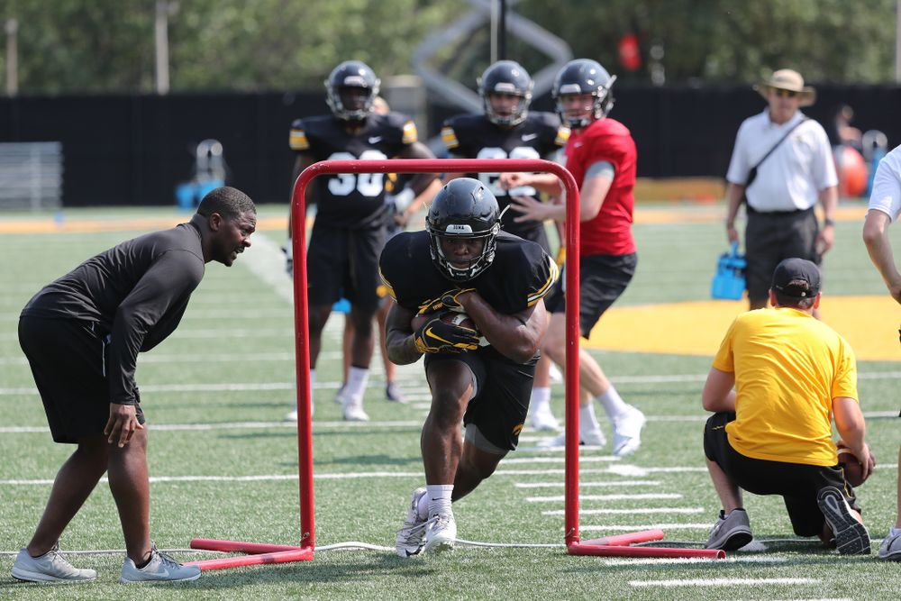 Iowa Hawkeyes running back Mekhi Sargent (10) and running backs coach Derrick Foster during the third practice of fall camp Sunday, August 5, 2018 at the Kenyon Football Practice Facility. (Brian Ray/hawkeyesports.com)