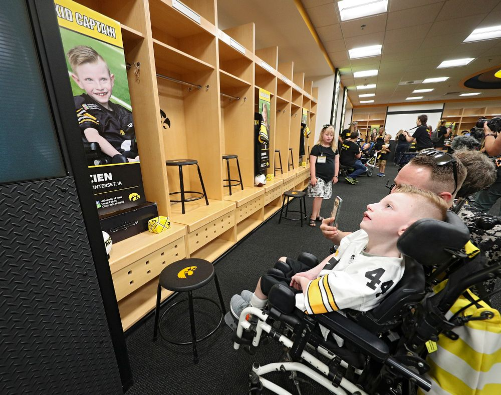 Kid Captain Cien Currie looks at his locker in the Iowa locker room during Kids Day at Kinnick Stadium in Iowa City on Saturday, Aug 10, 2019. (Stephen Mally/hawkeyesports.com)