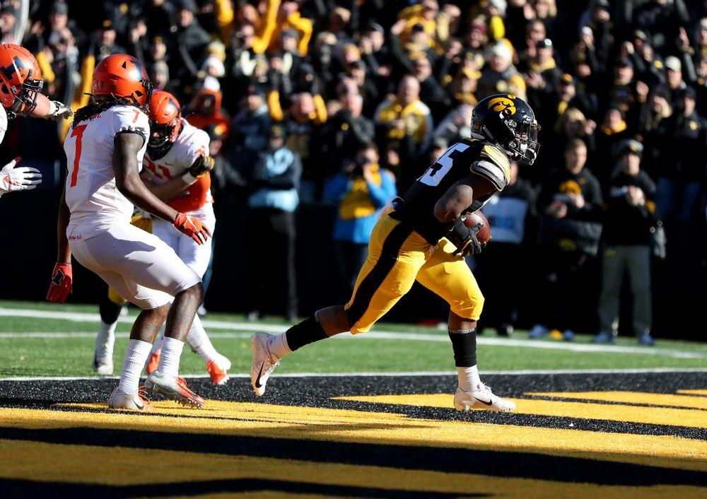 Iowa Hawkeyes running back Tyler Goodson (15) scores a touchdown against the Illinois Fighting Illini Saturday, November 23, 2019 at Kinnick Stadium. (Brian Ray/hawkeyesports.com)