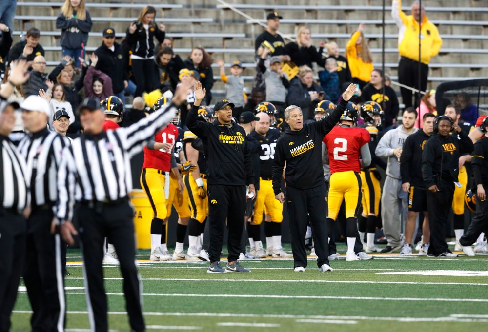 Iowa Hawkeyes head coach Kirk Ferentz and special teams coach LeVar Woods wave to patients in the Stead Family Children's Hospital during Iowa Football's final spring practice Friday, April 20, 2018 at Kinnick Stadium. (Brian Ray/hawkeyesports.com)