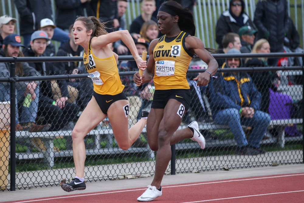 Iowa's Talia Buss and Antonise Christian during women's 4x100 meter relay at Big Ten Outdoor Track and Field Championships at Francis X. Cretzmeyer Track on Sunday, May 12, 2019. (Lily Smith/hawkeyesports.com)