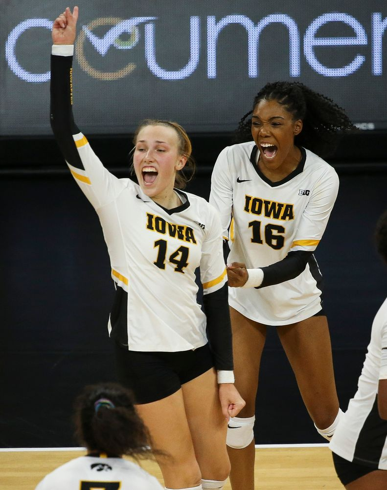 Iowa Hawkeyes outside hitter Cali Hoye (14) and Iowa Hawkeyes outside hitter Taylor Louis (16) react after winning a point during a game against Purdue at Carver-Hawkeye Arena on October 13, 2018. (Tork Mason/hawkeyesports.com)