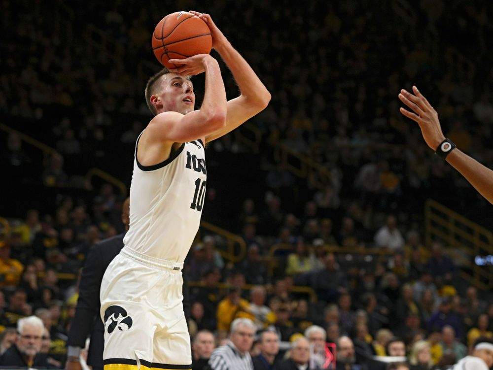 Iowa Hawkeyes guard Joe Wieskamp (10) lines up a shot during the first half of their their game at Carver-Hawkeye Arena in Iowa City on Sunday, December 29, 2019. (Stephen Mally/hawkeyesports.com)