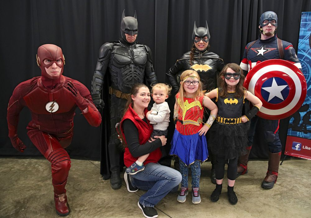 Fans get a picture with a group of superheroes on Superhero and Princess Day before the meet at Carver-Hawkeye Arena in Iowa City on Sunday, March 8, 2020. (Stephen Mally/hawkeyesports.com)