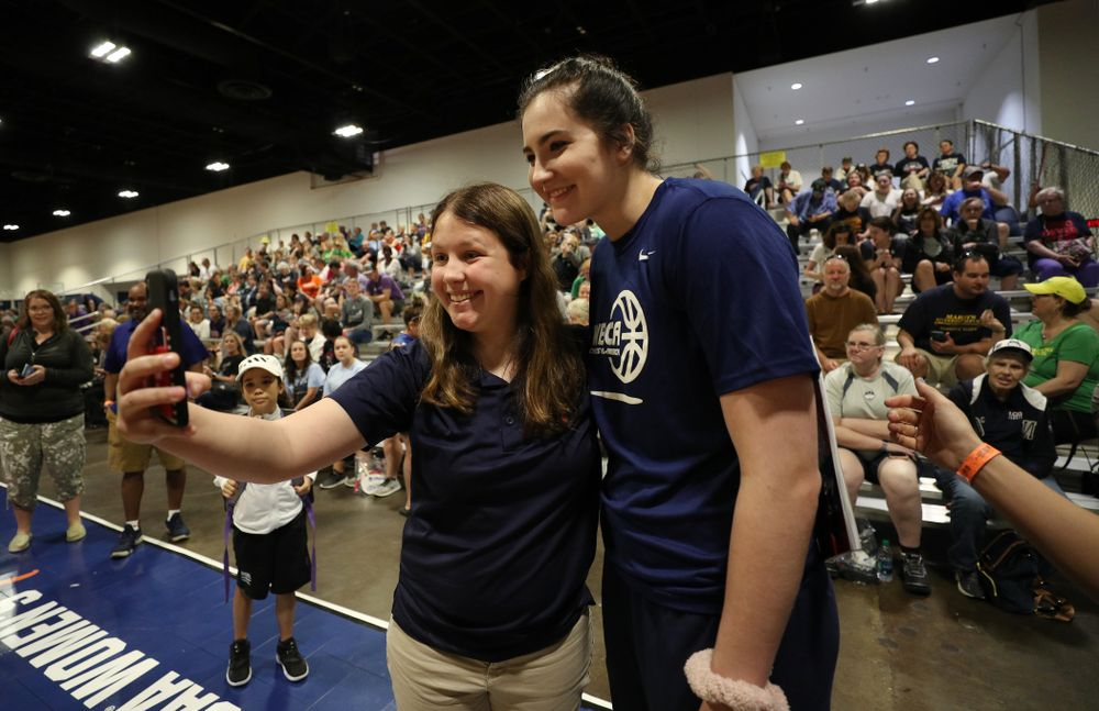 Iowa Hawkeyes forward Megan Gustafson (10) takes photos with a fan at the Tourney Town Fan Fest Friday, April 5, 2019 at the Tampa Convention Center in Tampa, FL. (Brian Ray/hawkeyesports.com)