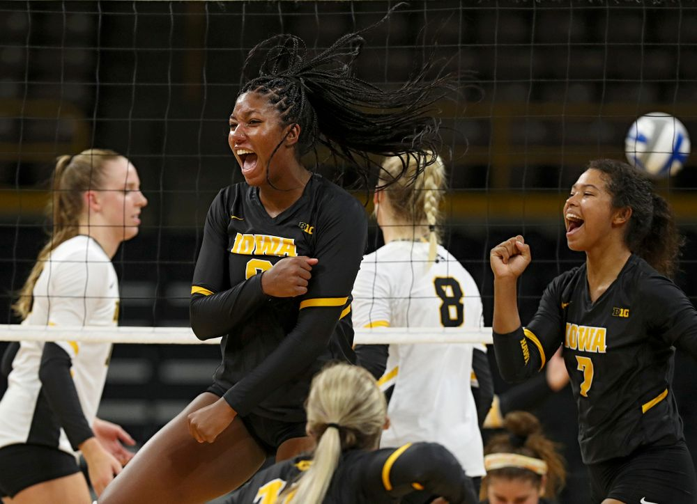 Iowa's Amiya Jones (9) and Brie Orr (7) celebrate during the first set of the Black and Gold scrimmage at Carver-Hawkeye Arena in Iowa City on Saturday, Aug 24, 2019. (Stephen Mally/hawkeyesports.com)