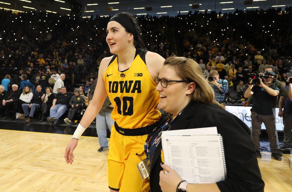 Iowa Hawkeyes forward Megan Gustafson (10) and SID Brandee Britt against the Northwestern Wildcats Sunday, March 3, 2019 at Carver-Hawkeye Arena. (Brian Ray/hawkeyesports.com)