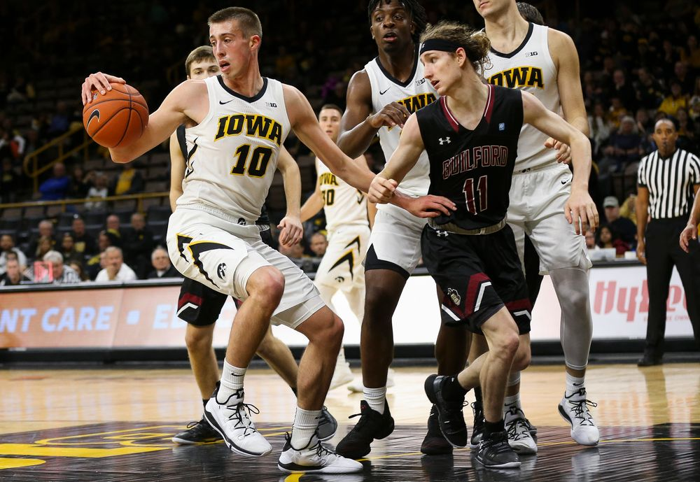 Iowa Hawkeyes guard Joe Wieskamp (10) grabs a rebound during a game against Guilford College at Carver-Hawkeye Arena on November 4, 2018. (Tork Mason/hawkeyesports.com)