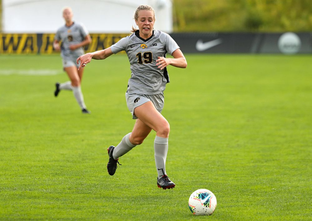 Iowa forward Jenny Cape (19) eyes the ball during the first half of their match at the Iowa Soccer Complex in Iowa City on Sunday, Sep 1, 2019. (Stephen Mally/hawkeyesports.com)