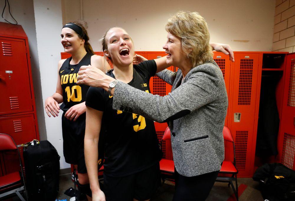 Iowa Hawkeyes guard Makenzie Meyer (3) and head coach Lisa Bluder
