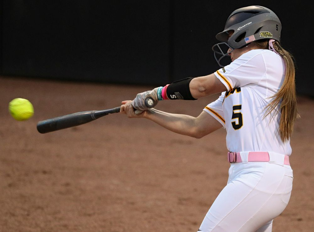 Iowa shortstop Sydney Owens (5) hits a double during the fifth inning of their game against Iowa State at Pearl Field in Iowa City on Tuesday, Apr. 9, 2019. (Stephen Mally/hawkeyesports.com)