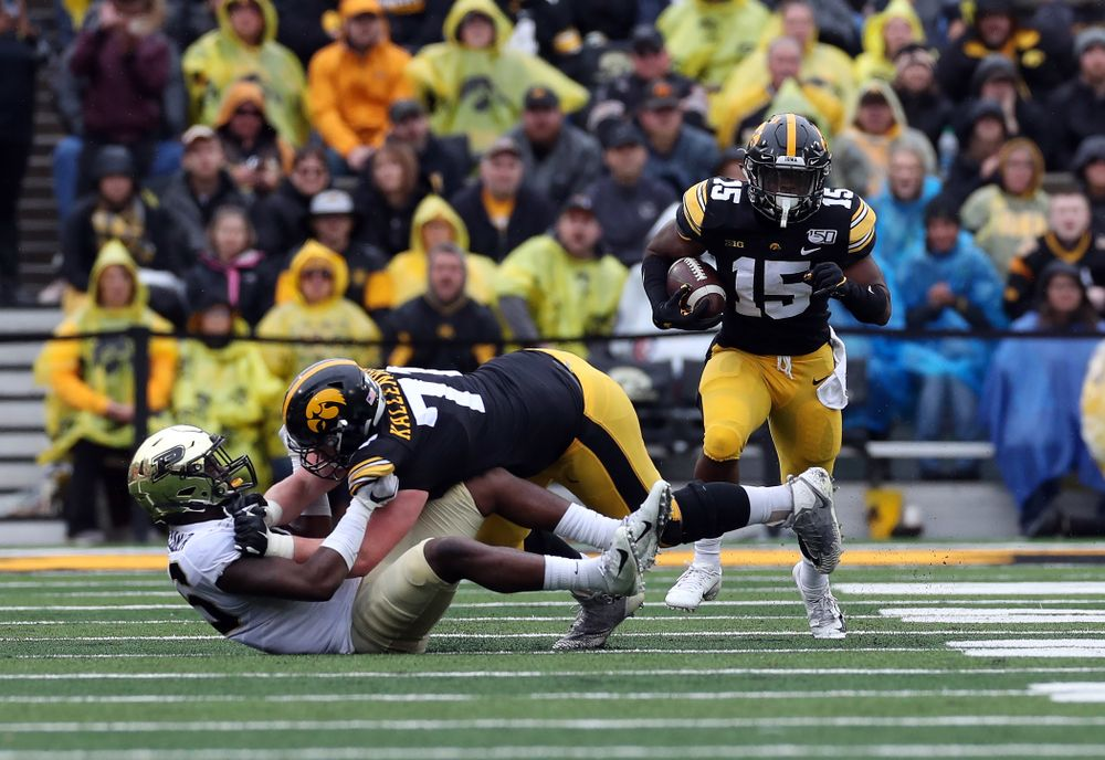 Iowa Hawkeyes running back Tyler Goodson (15) and offensive lineman Mark Kallenberger (71) against the Purdue Boilermakers Saturday, October 19, 2019 at Kinnick Stadium. (Brian Ray/hawkeyesports.com)