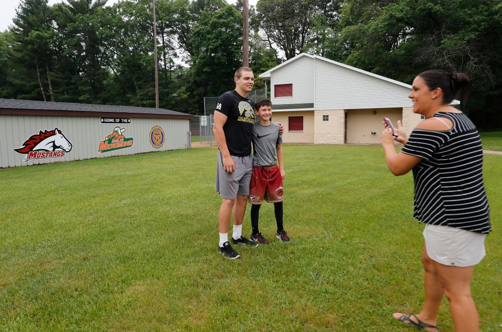 Iowa Hawkeyes quarterback Nathan Stanley (4) takes a photo with a young fan outside of his high school baseball field Wednesday, May 30, 2018 in Menomonie, Wisc. (Brian Ray/hawkeyesports.com)