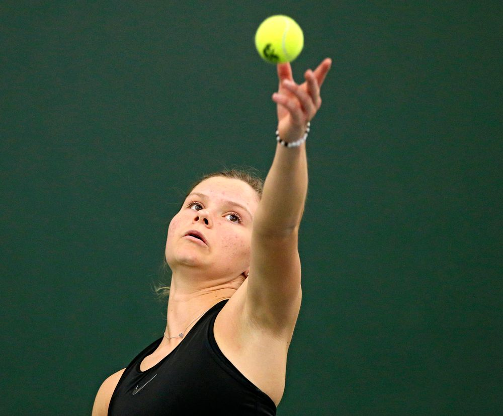 Iowa's Cloe Ruette serves the ball during their doubles match against Indiana at the Hawkeye Tennis and Recreation Complex in Iowa City on Sunday, Mar. 31, 2019. (Stephen Mally/hawkeyesports.com)
