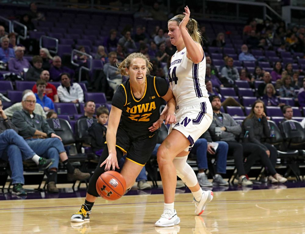 Iowa Hawkeyes guard Kathleen Doyle (22) drives to the hoop during the third quarter of their game at Welsh-Ryan Arena in Evanston, Ill. on Sunday, January 5, 2020. (Stephen Mally/hawkeyesports.com)