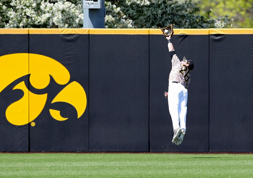 Iowa Hawkeyes left fielder Chris Whelan (28) makes a diving catch for an out during the third inning of their game against UC Irvine at Duane Banks Field in Iowa City on Sunday, May. 5, 2019. (Stephen Mally/hawkeyesports.com)