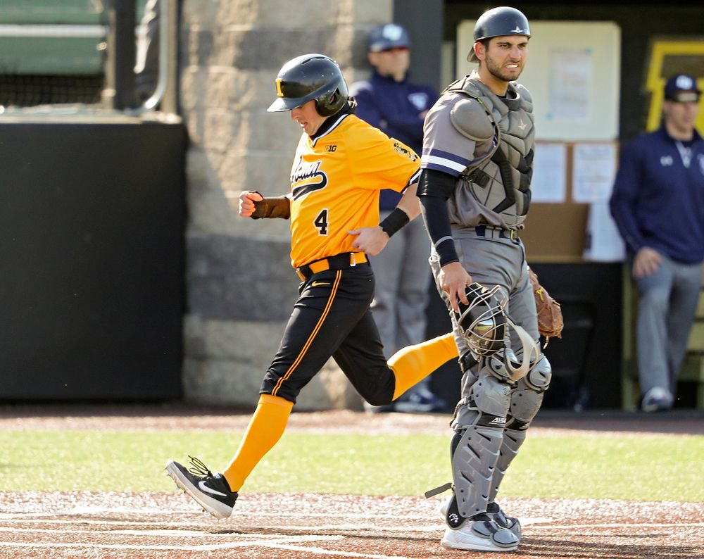 Iowa Hawkeyes second baseman Mitchell Boe (4) scores a run during the first inning of their game at Duane Banks Field in Iowa City on Tuesday, Apr. 2, 2019. (Stephen Mally/hawkeyesports.com)